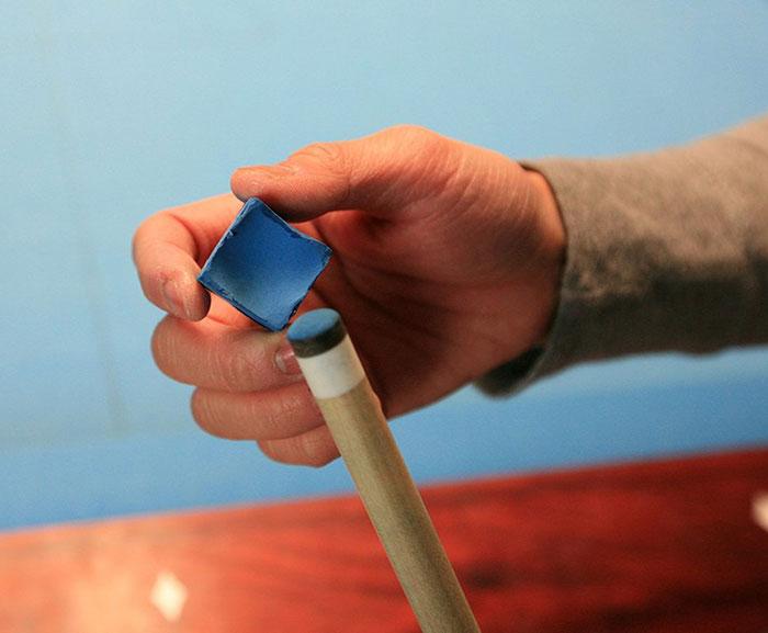 hand holding cue chalk