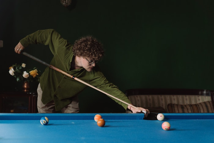 Guess material of pool table through gameplay
