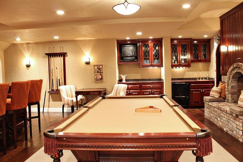 tan pool table in living room